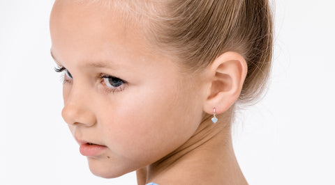 young girl wearing sterling kids earrings from nz