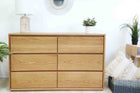 Lifestyle image of chest of drawers. Made from sustainably sourced timber. This image show American White Oak.