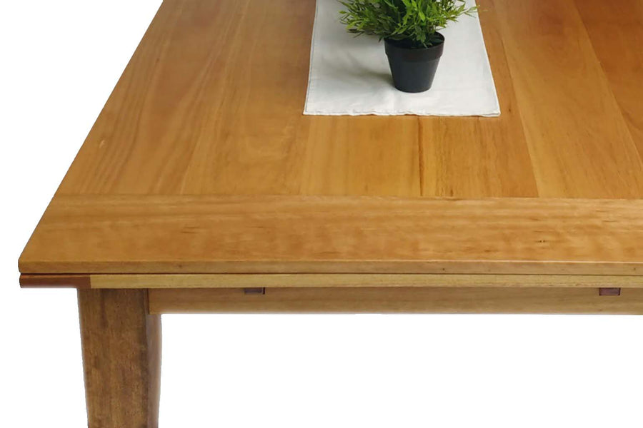 Close up image of Dutch Pull Out Extendable Dining Table. This image shows the table made from sustainably sourced Blackbutt.