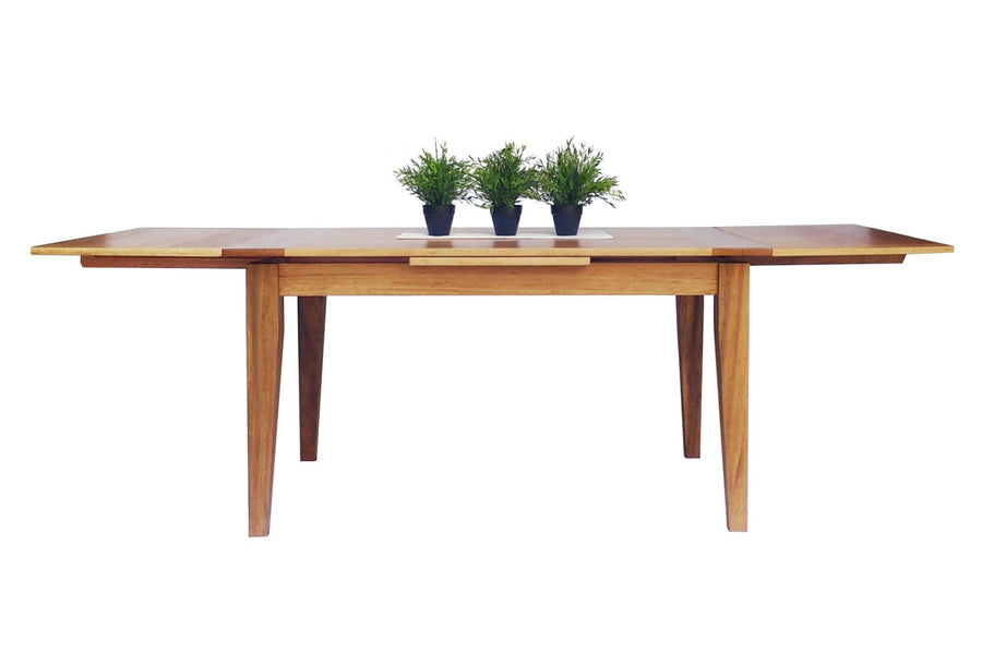 Dutch Pull Out Extendable Dining Table Lifestyle Image. This images shows the table made from sustainably sourced Blackbutt.