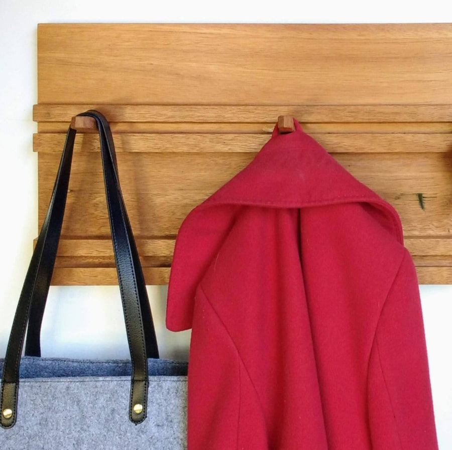 Sliding Peg Coat Rack Closeup