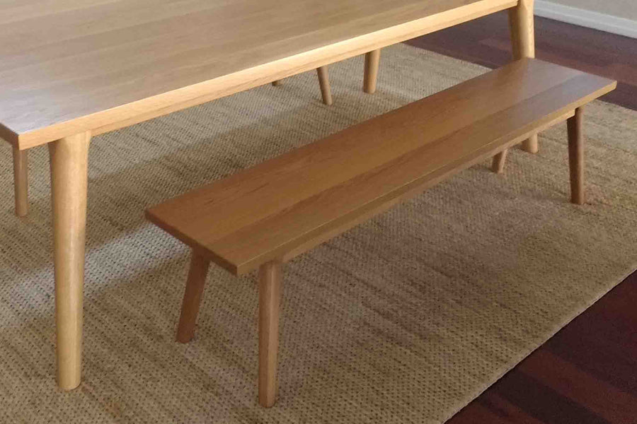 Lifestyle image of Signature Timber Dining Bench Seat. Made to order from a range of sustainably sourced timber. This image shows American White Oak.