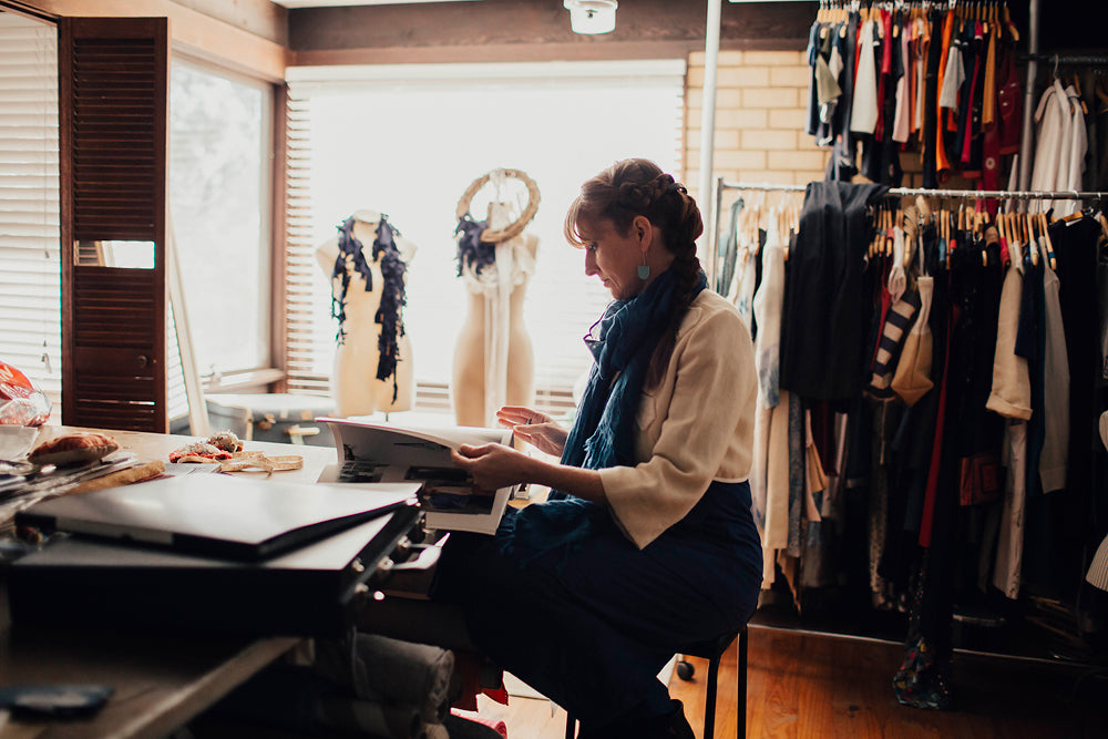 Designer in her fashion studio
