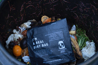 compostable bag in compost bin