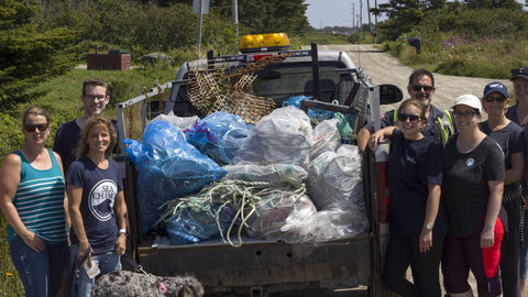 The volunteers with a truckload of trash removed from the beach.