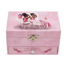 Pink music box with a image of Nia Ballerina who is a black ballerina sitting down at a dressing table.