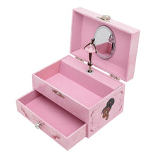 Pink jewellery box for children with a black ballerina figurine inside.