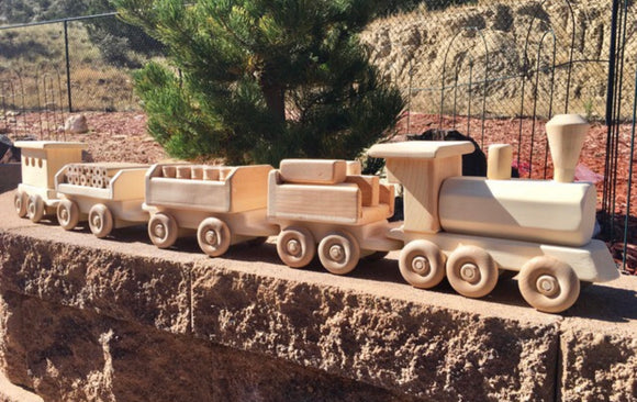 Hand crafted wooden train by Jumpster's Wood Werks.