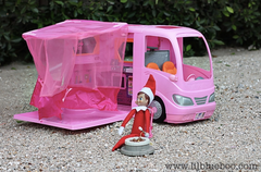 Elf on the Shelf driving barbies car