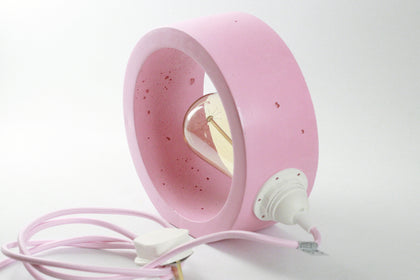 White concrete hollow cube light and faceted concrete plant pot