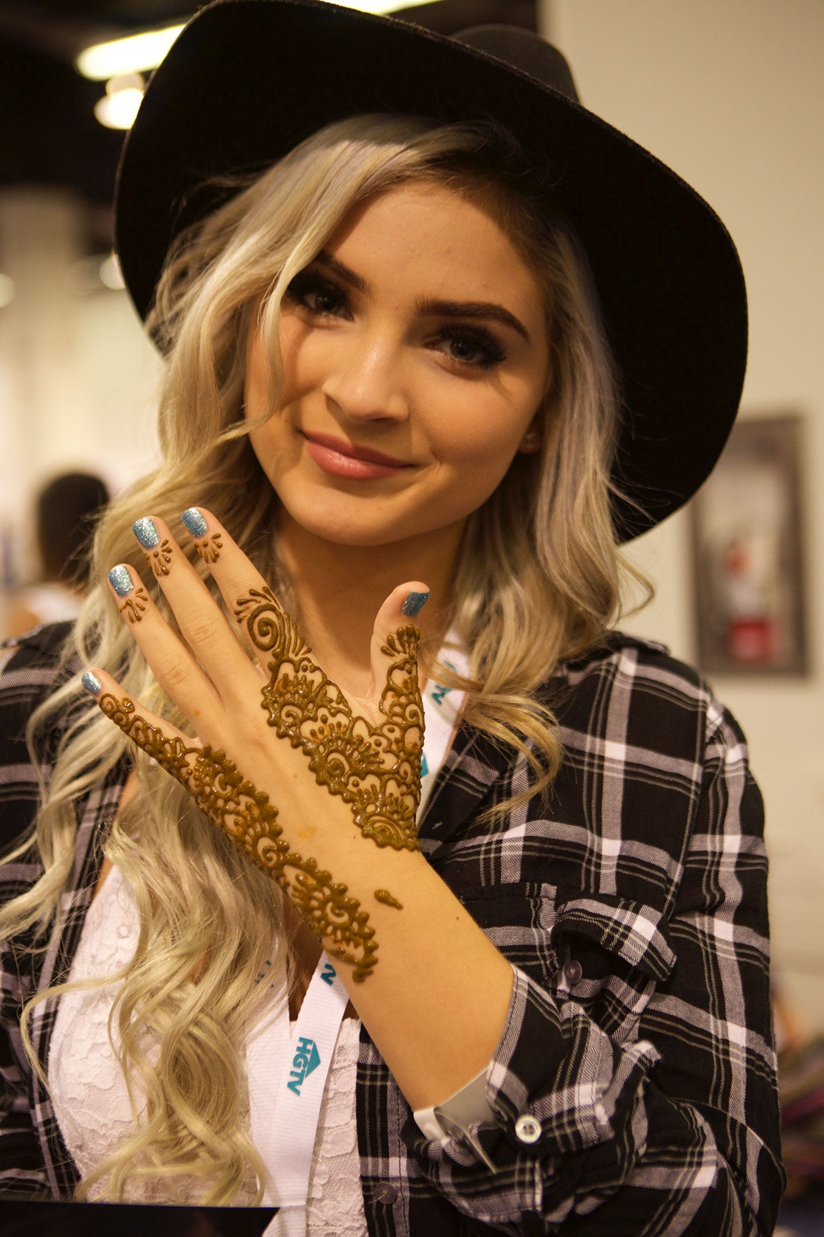 Young lady with henna tattoos on her fingers