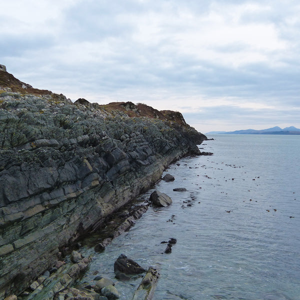 Ancient Dalradian Cliffs, Ardfern, Argyll, Scotland looking over the sea to Jura