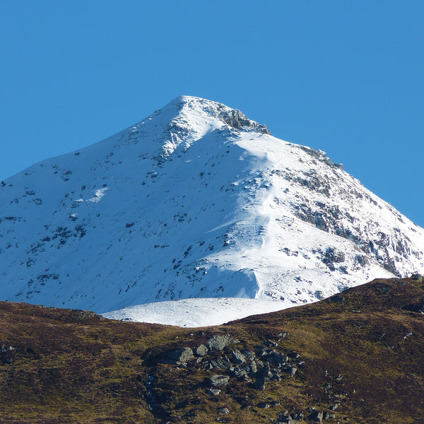 North West Ridge of Ben Lomond in the Snow on a perfect Spring day in Scotland