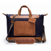 Canvas and Leather Weekender | Shoulder strap View | Goose | Blue canvas and pebbled brown leatherr | Quavaro
