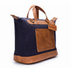 Canvas and Leather Weekender | Side View | Goose | Blue canvas and pebbled brown leatherr | Quavaro