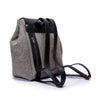 Canvas and Leather Backpack | Side View | Piper | Grey herringbone canvas and black leather | Quavaro