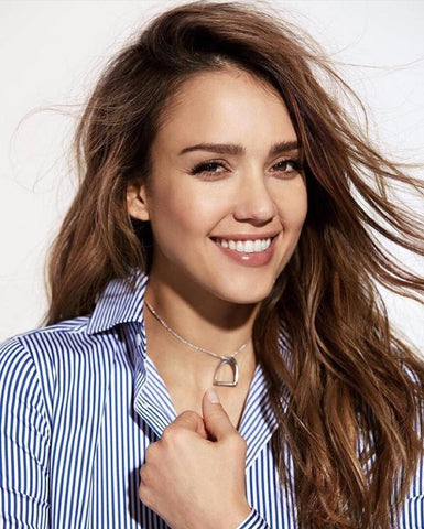 Jessica Alba wearing necklace and blue and white stripped shirt.