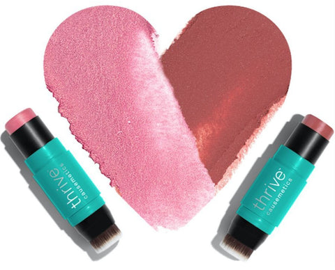 Thrive cosmetics with heart-shaped makeup on table.