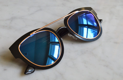 Black frame with reflective blue lenses and rose gold brow bar detail
