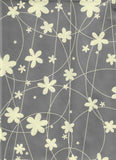 Silver gift wrap with creme flowers