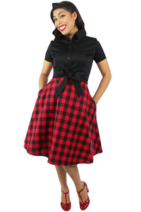 Model wearing black knot top with plaid red and black circle skirt, Pictured from the front