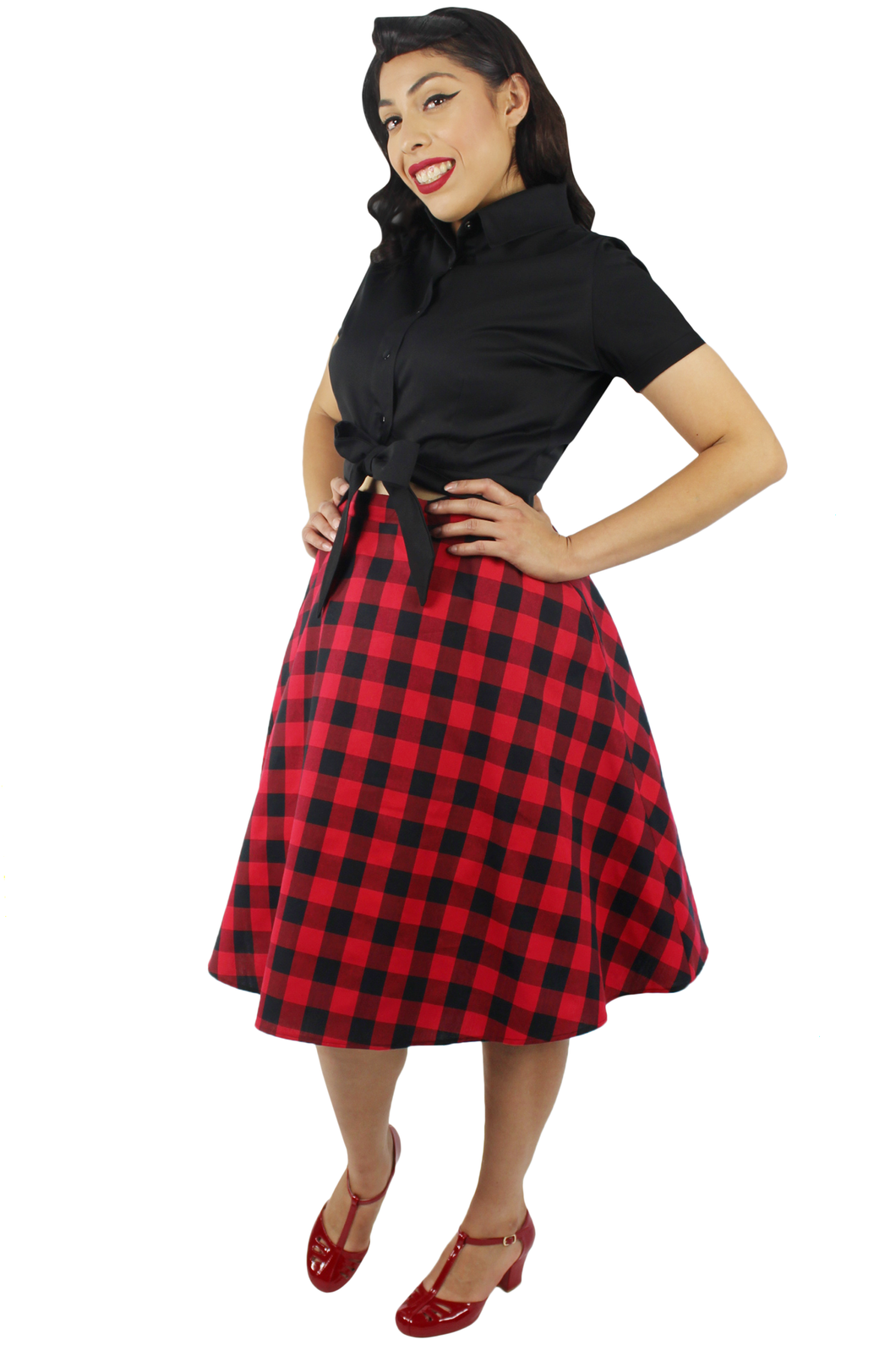 Model wearing black knot top with plaid red and black circle skirt, Pictured from the side