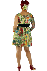 Model wearing dress and tropical hair flower, red BAIT shoes