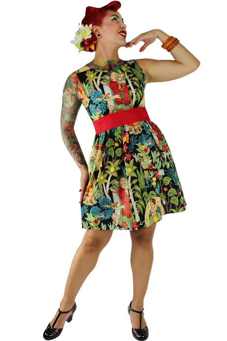 Pin up model wearing the dress, tropical flower on hair, black BAIT shoes