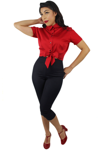 Model wearing knot top with capri pants and red BAIT shoes, Pictured from the front-side