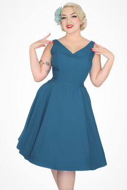 Model in Teal Flowy Dress With Pockets Front