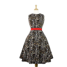 Load image into Gallery viewer, Dress on mannequin, Pictured from the front, Leopard print all throughout, Red waist band