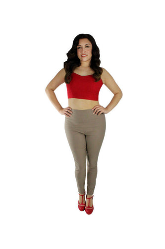 Model wearing pants with red crop top, Hands on waist