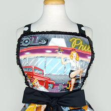 Load image into Gallery viewer, Close up of apron, Upper part of apron, Black trim, Images of Pin Up holding a tray in front of diner