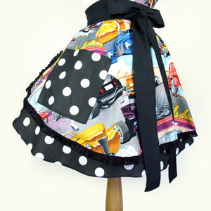 Close up of bottom of apron, large side pocket in black with large white polkadots