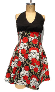 Front side of dress, dress on mannequin, Upper top is black, Bottom composed of printed fabric