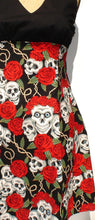 Load image into Gallery viewer, Close up of fabric, Repeasted pattern of skulls wearing flower crowns between green vines