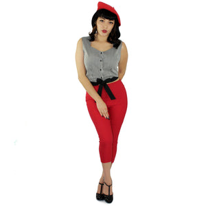 Model wearing the knot top with red capri pants and red cap