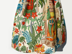 Bottom of dress featuring green jungle leaves and flowers