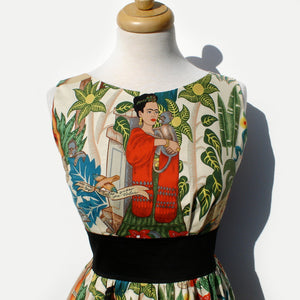 """Head Over Wheels"" Frida Kahlo Dress in Beige Close up of Collar, Frida wearing a red scarf around her neck surrounded by leaves"