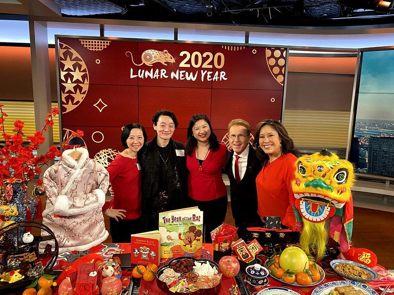 Joanne Kwong and Pearl River staff with CBS news anchor Cindy Hsu and memeteorologist John Elliot