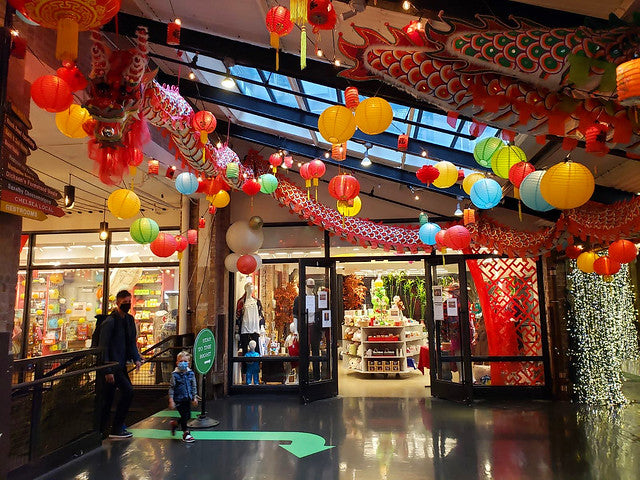 Outside of Pearl River Mart at Chelsea Market with dragon and lantern decor