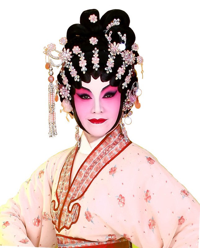 Woman dressed in extravagant Chinese opera makeup and costume