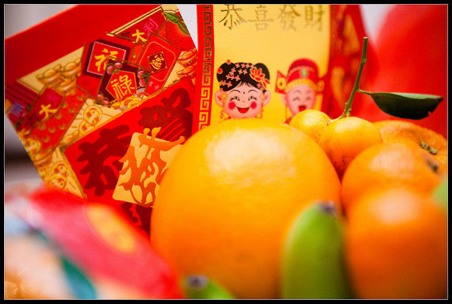 Red envelopes and oranges for Chinese New Year