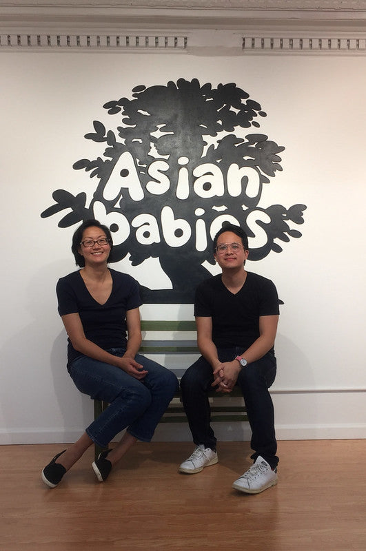Amy Hwang and Jeremy Nguyen in front of Asian Babies mural
