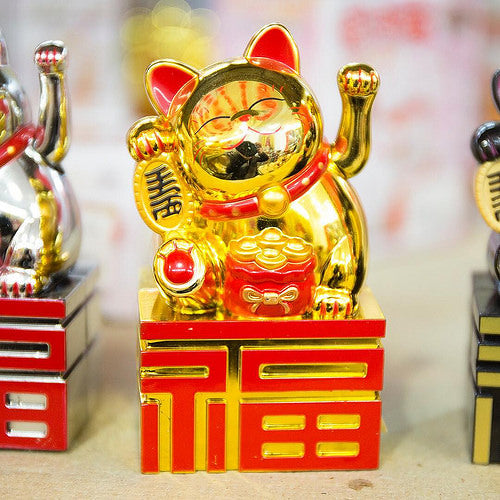 A shiny gold lucky cat