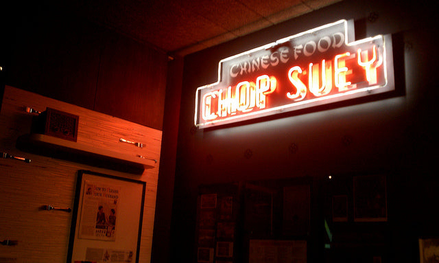 A neon sign of a chop suey restaurant in an exhibit at the Museum of Chinese in America