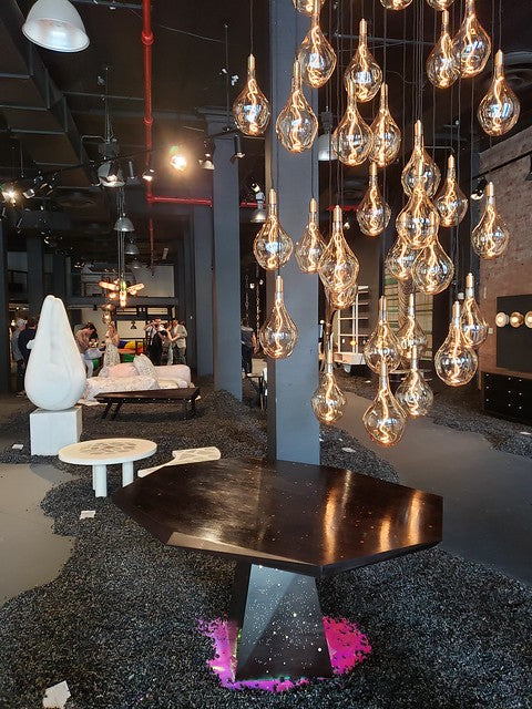 Next Level's NYCxDesign 2019 gallery space with beautiful contemporary chandelier and furniture
