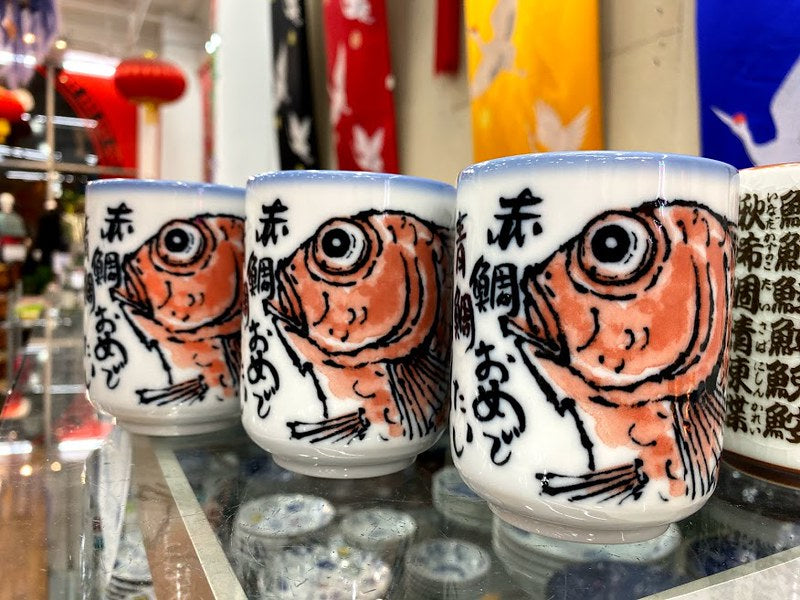 Three Japanese tea cups with red sea bream