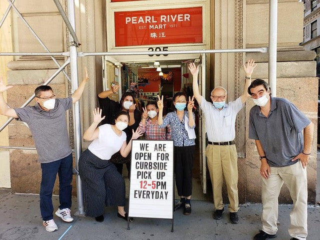 Group with masks in front of Pearl River Mart Tribeca after reopning