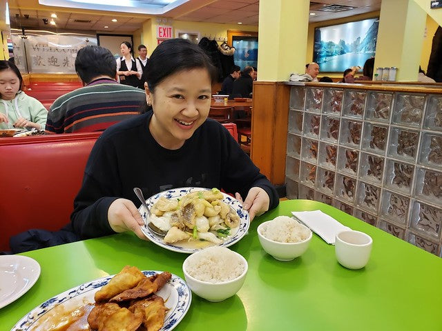 Joanne Kwong enjoying fried flounder at Wo Hop
